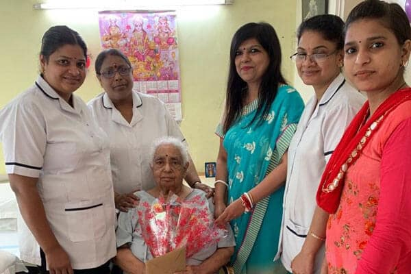Carestay resident Dr. Kalyani enjoys her birthday celebration.